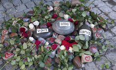 """""""Grief in the public domain"""". The installation of roses and hearts with stones and the inscription """"Our little country"""" at Oslo Cathedral 22.08.2011, a month after the terrorist attacks in Oslo and on Utøya."""