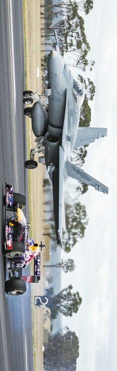 Always up for a challenge: Daniel Ricciardo's F1 car v Royal Australian Air Force Hornet. Image: Andy Green http://win.gs/1ezGfUS #f1 #redbullracing #raaf #hornet