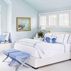 Master Bedroom: monochromatic palette of soft blues. Walls - Benjamin Moore's Sweet Bluette. Fabrics -soft periwinkle.  (bed ~ Mitchell Gold, bedding ~ Matouk, benches ~ Romo fabric, Pillow fabrics ~ China Seas, David Hicks, and Lee Jofa. ) CoastalLiving.com