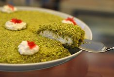 Bohsalino reminds me of my grandmother's kitchen and how dedicated she is as a cook and baker. I always watch her prepare this Lebanese dessert when she visits Lebanon. It used to look so complex to me: grinding the pistachios, magically turning them into a sweet paste, and sandwiching it with creamy kashta (fresh Lebanese…