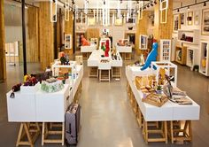 """The work of Taiwanese Good Studio, the shop was designed under the theme """"Windows."""" Throughout the store, a variety of different frames hung on the walls and ceiling encourage visitors """"to look out onto a new world."""""""