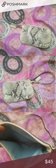 Coach wristlet NWOT. Authentic Coach Beautiful shimmery snakeskin fabric wristlet with a gorgeous tiffany blue interior. Pictures really do not do it justice! Coach Bags Clutches & Wristlets