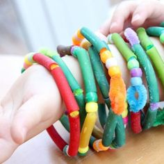These bracelets are so colorful and fun to make and wear, for both boys and girls! You can make these rainbow bracelets after dying your pasta in Kool-Aid. http://www.whoseturnnow.com/kool-aid-dyed-pasta