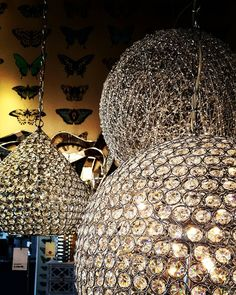 Three different Crystal Globe Pendant Lights in Modern Contemporary Styles, perfect for a style statement in your interior