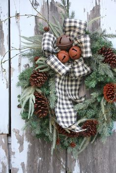 Evergreens, pine cones, gingham ribbon - insert in grapevine wreath and add rusted jingle bells ~ Sweet Something Designs
