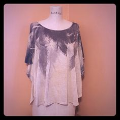 Shimmer feather top Oversized shimmer feather top with bat-wing sleeves Fabric: Polyester Care instructions: wash cold water / lay flat or hang to dry Stargazer from JCPENNY Tops Tees - Short Sleeve