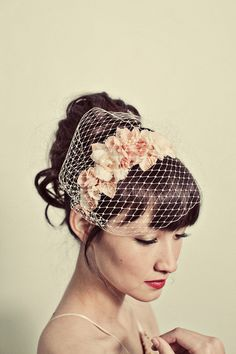 Or what about this one? It's making me want to wear my hair up! Handmade flowers headband with birdcage veil by mignonnehandmade. $140.00 USD, via Etsy.