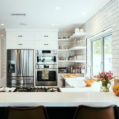Kitchen with quartz counters and subway tile