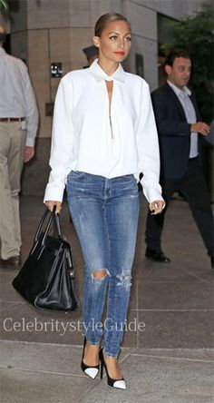 Seen on Celebrity Style Guide: While leaving her hotel in New York City on September 3 Nicole Richie was spotted wearing this white drape neck crepe blouse.