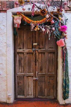 Door seen in the Santa Fe Village shopping arcade in Santa Fe, New Mexico.