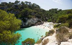 The gorgeous beach near Alaior, on the Balearic Island of Menorca, is known as Macarella and is an idyllic cove of white sand and turquoise waters. Menorca Beaches, Menorca Hotels, Uk Beaches, Ibiza, Cool Places To Visit, Places To Go, Hidden Beach, Balearic Islands, Turquoise Water