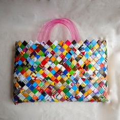 I remember weaving gum wrappers as a kid.  What a fun idea!