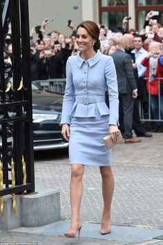 The Duchess looked impeccably polished in a bespoke Catherine Walker suit, which she teamed with her trusty nude suede heels as she arrived at the Mauritshuis gallery in The Hague on her one-day visit to Holland