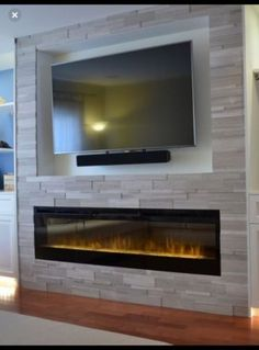 Best Snap Shots Fireplace Remodel off center Suggestions 64 Ideas Living Room Tv Wall Fireplace Entertainment Center Fireplace Tv Wall, Linear Fireplace, Basement Fireplace, Fireplace Remodel, Fireplace Surrounds, Fireplace Design, Fireplace Ideas, Stone Wall With Fireplace, Electric Wall Fireplace