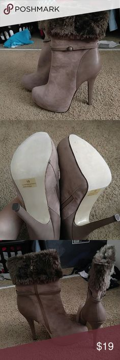 New Fur ankle boots Brand new fur ankle boots. Really pretty taupe/light brown color. Manufacturer defect with glue showing from sole but cannot see when worn and there is a tiny spot from me storing the shoes. Price firm. Shoes Ankle Boots & Booties