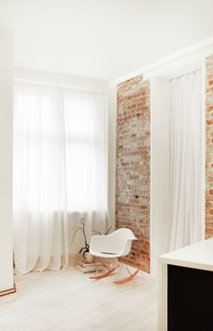 Ceiling to floor flow curtains with beautiful brick walls and wooden flooring #minimal #NYstyle
