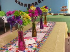Teachers table to sit at and eat. Dollar tree vases and flowers from Costco. I made the table runner (fabric is from Joanns)