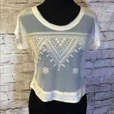 ✌FREE PEOPLE SEMI SHEER CROP TOP✌️ Beautiful crop top with pretty embroidery detail in Aztec design. Like new Free People Tops Crop Tops
