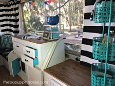 I love the bright colors on the insides of the drawers and cabinets.  Adorable!