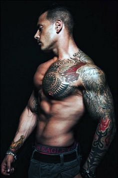 Impressive fill sleeve and chest tattoo.