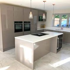 Hacker Handleless Kitchen With Quartz Worktops and Island. Check out of used and ex display kitchens at a fraction of their RRP Kitchen Sale, Home Decor Kitchen, Kitchen Interior, New Kitchen, Kitchen Unit, Stone Kitchen, Stools For Kitchen Island, Modern Kitchen Island, Modern Kitchen Design