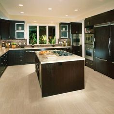 dark cabinets. light counters. light floors.