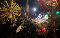 Revelers take pictures of a fire dragon dance in Hong Kong on the 2010 autumnal equinox