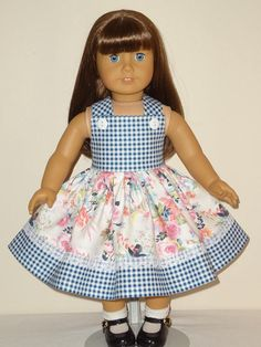 The dress is made from a white floral print including pink, yellow and blue flowers. The dress bottom and bodice are made from a blue and white check gingham and trimmed with white lace. Bodice is lined. All seams are serged. All of my doll items are handmade by me. Shipped priority