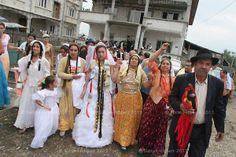 Garoafa Mihai (in wedding dress, centre), aged 14, is taken from her family home by her husband-to-be's family during the celebrations of her wedding to 13 year old Florin 'Ciprian' Lulu