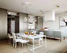 eat in kitchen gray cabinets island marble top dining room table mix match chairs Eat In Kitchen, Kitchen Dining, Kitchen Decor, Open Kitchen, Kitchen Island, Kitchen Grey, Design Kitchen, Kitchen Furniture, Island Cooktop