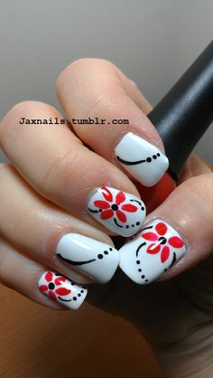 Red flower with black dots on white nails (:.