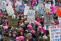 Women with bright pink hats and signs begin to gather early and are set to make their voices heard on the first full day of Donald Trump's presidency, Saturday, Jan. 21, 2017 in Washington.