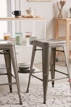 Gunmetal/silver colored counter stool made of steel. The staple piece for bistros and kitchens with rustic, farmhouse decor.