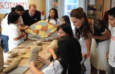 Prince William, Duke of Cambridge and Catherine, Duchess of Cambridge participate in a ceramics class during their visit to Inner City Arts on July 10, 2011 in Los Angeles, California.