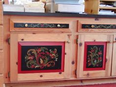 Cubbords and drawers are decorated by rosemaling