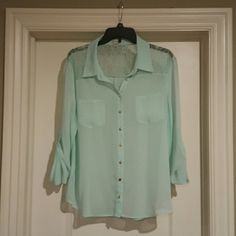 Guess mint green button down Beautiful sheer mint green button down shirt with lacy back/shoulder panel. Has shiny gold buttons. Has one tiny mark on the back of the shirt, but hardly noticeable. Very flowy and flattering on!  In great condition! Guess Tops Button Down Shirts