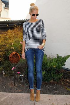 Casual and super cute. Aviator sunglasses + Stripes + skinny jeans + ankle boots + top knot
