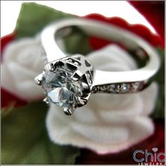 Gorgeous engagement ring with crown like jeweled prongs that hold 0 75 AAA high quality round stone Sides of the shank are set with graduate small round pave set stones Shape RoundCarat Weight 0 center 0 sides TCW 1 Cubic Zirconia Engagement Rings, Diamond Engagement Rings, White Gold Rings, Natural Diamonds, Wedding Rings, Crown, Stone, Beauty, Jewelry