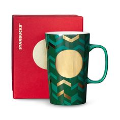 A ceramic coffee mug with a chevron design, green exterior and metallic accents. Part of our Dot Collection.