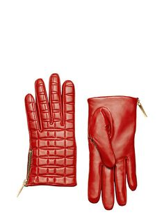 a perfect pair: the stitching on these quilted lamb-leather gloves suggests bows, lending them a slightly fanciful air. but the warm lining and zip-up sides make them practical, as well. wear them whe
