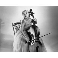 Posterazzi Young woman sitting on a chair and playing a cello Canvas Art - (24 x 36)