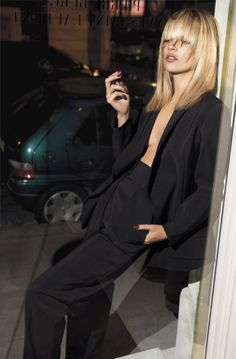"Kate Moss wearing Yves Saint Laurent suit. ""The man who put women in trousers."""