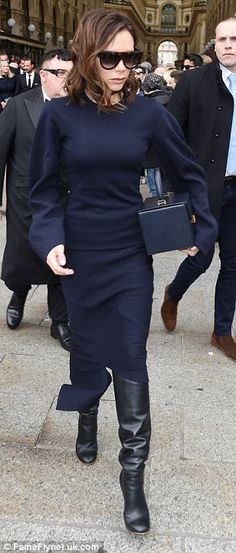 Firm friend: Victoria Beckham wore a conservative navy dress to attend a star-studded religious ceremony in honour of the late Vogue Italia editor-in-chief Franca Sozzani in Milan on Monday who passed away in December aged 66