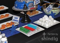 star wars food table - light sabers - are they dipped pretzel rods with foil ends? love the death star donuts!