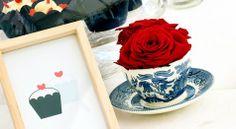 Flowers in teacups.