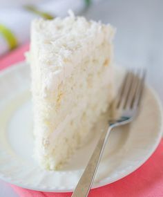 Coconut Cake with Coconut Meringue Buttercream Frosting by browneyedbaker #Cake #Coconut