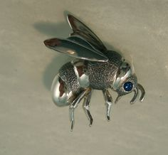 silver bee pin with blue sapphire eye