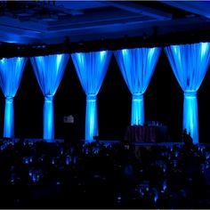 Event Drapes | White drape on black drape with blue lighting