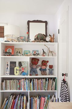 Decorate the nursery with vintage books and classic toys.