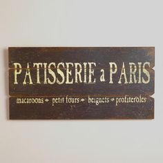 Too bad they spelled macarons wrong...One of my favorite discoveries at WorldMarket.com: Patisserie a Paris Sign